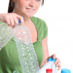 Teenage girl sorting the recycling — Stock Photo