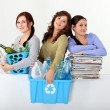 Young women recycling - Stock Photo