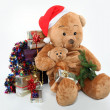 Huge teddy bear and Christmas gifts on white background — Stock Photo #14683375