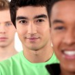 Three teenage men stood in a row — Stock Photo #14684715