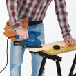 Carpenter at work with sander machine — Stock Photo