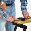 A carpenter taking measures. — Stock Photo