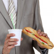 Stock Photo: Businessmholding sandwich and soft drink