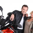 Biker couple with hand on shoulder. — Stock Photo #14688035