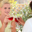 Couple drinking wine outdoors — Stock Photo