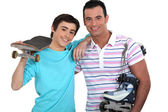 Young with skateboards and rollerblades — Stock Photo