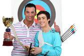 Boy receiving archery trophy — Stock Photo