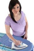 Brunette woman ironing — Stock Photo