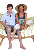 Teen Couple on hammock — Stock Photo