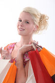 Woman with bags full of purchases — Stock Photo