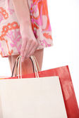 Hans of a woman with bags — Stock Photo