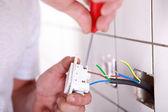 Installing a plug — Stock Photo