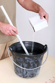 Man mixing up plaster — Stock Photo