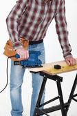 Carpenter at work with sander machine — Stock Photo