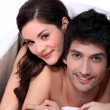 Couple laying in their bed — Stock Photo
