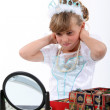 Young girl playing dress-up — Stock Photo