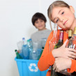 A girl and a boy recycling glass bottles — Stock Photo #14692577