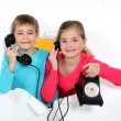Brother and sister with old-fashioned telephone — Stock Photo