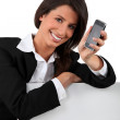 Young woman holding mobile telephone — Stock Photo