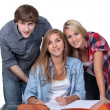 Students working together at a desk — Stock Photo #14699607