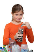 Girl recycling batteries — Foto de Stock