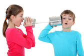 Kids playing with tins — Stock Photo