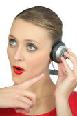 Surprised woman wearing headphones — Stock Photo