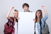 Three teenagers with backpacks — Stock Photo
