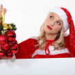 Mrs. Santa is in charge of Christmas decorations — Stock Photo