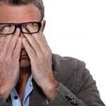 Man rubbing his eyes — Stock Photo
