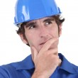 A pensive manual worker. — Stock Photo