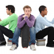Three bored male students — Stock Photo