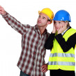Stock Photo: Architect and foremlooking at problem