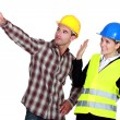 Stock Photo: Construction worker pointing out problem while his co-worker denies any involvement