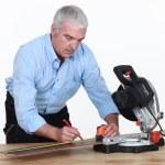 A senior carpenter with a circular saw. — Stock Photo #14704751