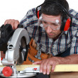 Carpenter cutting wood — Stock Photo