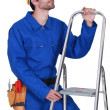 Stock Photo: Manual worker with stepladder