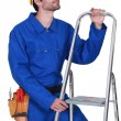 Manual worker with stepladder — Stockfoto #14705025