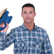 Carpenter holding electric sander — Stock Photo #14705113