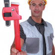 Plumber showing spanner — Stock Photo