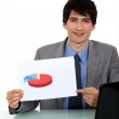 Businessman with a pie chart — Stock Photo #14705289