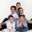 Parents and three children sat together — Stock Photo