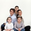 Parents with three children in studio — Stock Photo
