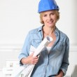 Female architect with plans — Stock Photo #14706317