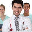 Stock Photo: Doctor and nurses laughing