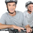 Mature couple biking. — Stock Photo