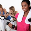 Royalty-Free Stock Photo: Three women at the gym.