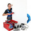 Female labourer surrounded by tools — Stock Photo