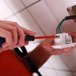 Electrician working in bathroom — Stock Photo