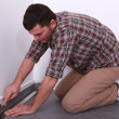 Man laying linoleum — Stock Photo #14707513